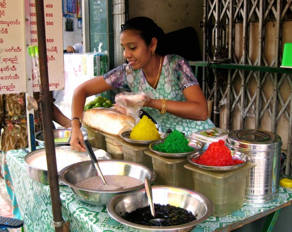 Beautiful Burmese woman selling food on the streets of Yangon, Myanmar