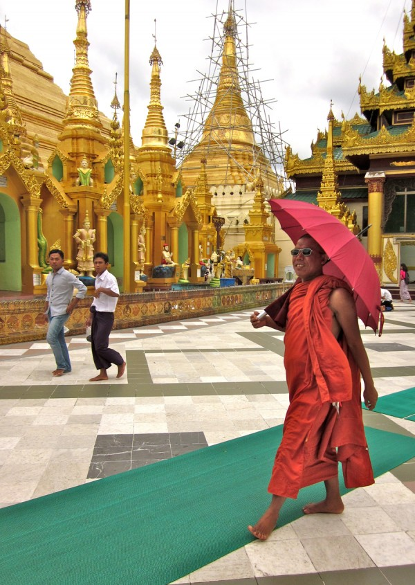 Buddhist monk truts around Shwedagon Pagoda, Yangon, Myanmar