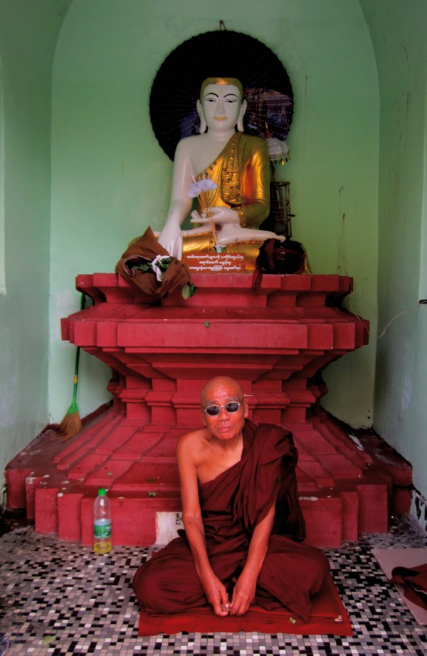 Buddhist monk chilling in state of nirvana at Shwedagon Pagoda, Yangon, Myanmar