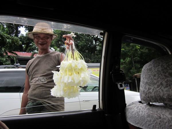 Yangon orchid salesman in longyi