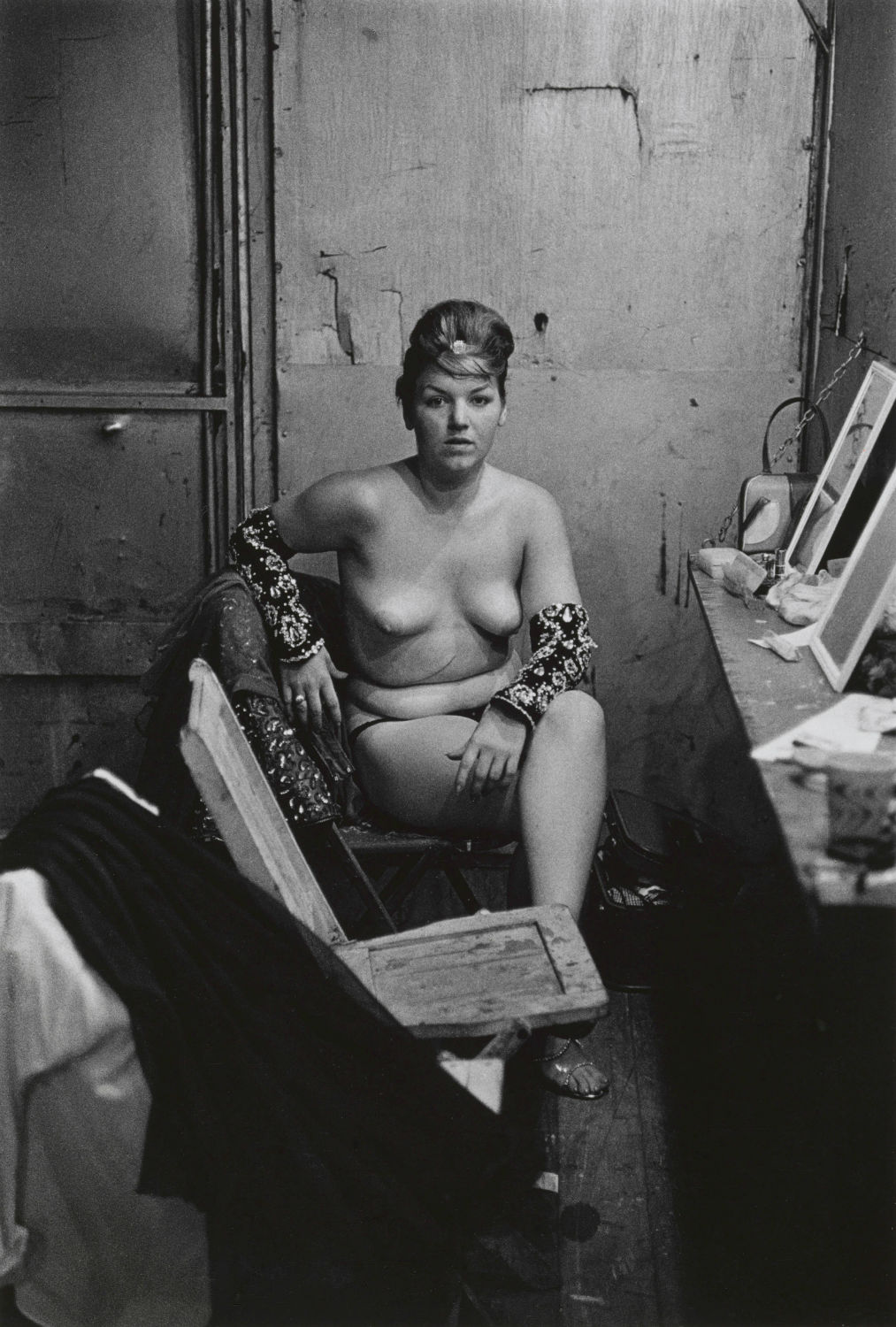 11.-Stripper-with-bare-breasts-sitting-in-her-dressing-room-Atlantic-City-N.J.-1961