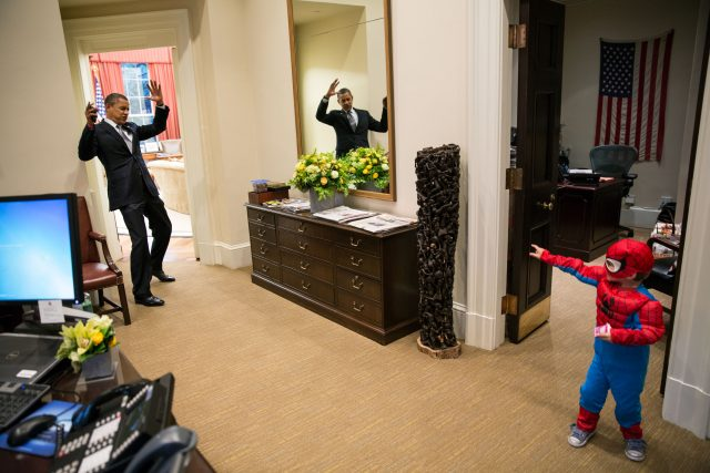 "Oct. 26, 2012 ""The President to be caught in Spider-Man's web as he greets the Nicholas Tamarin, 3, just outside the Oval Office. Spider-Man had been trick-or-treating for an early Halloween with his father, White House aide Nate Tamarin in the Eisenhower Executive Office Building. I can never commit to calling any picture my favorite, but the President told me that this was HIS favorite picture of the year when he saw it hanging in the West Wing a couple of weeks later."" (Official White House Photo by Pete Souza) This official White House photograph is being made available only for publication by news organizations and/or for personal use printing by the subject(s) of the photograph. The photograph may not be manipulated in any way and may not be used in commercial or political materials, advertisements, emails, products, promotions that in any way suggests approval or endorsement of the President, the First Family, or the White House."